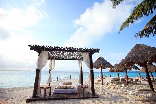 Find shade under a rustic palapa