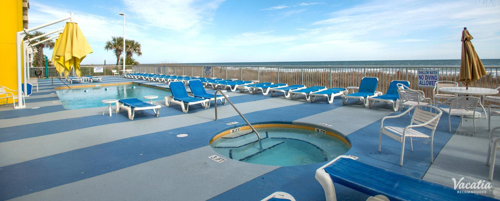 Seaside Resort poolside deck on beach